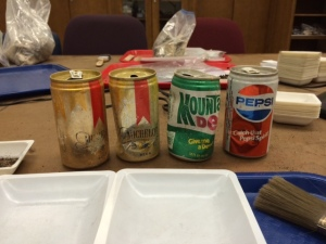 """Old"" pop cans recovered from disturbed deposits at a Port Clarence site (Photo by John Esh)."